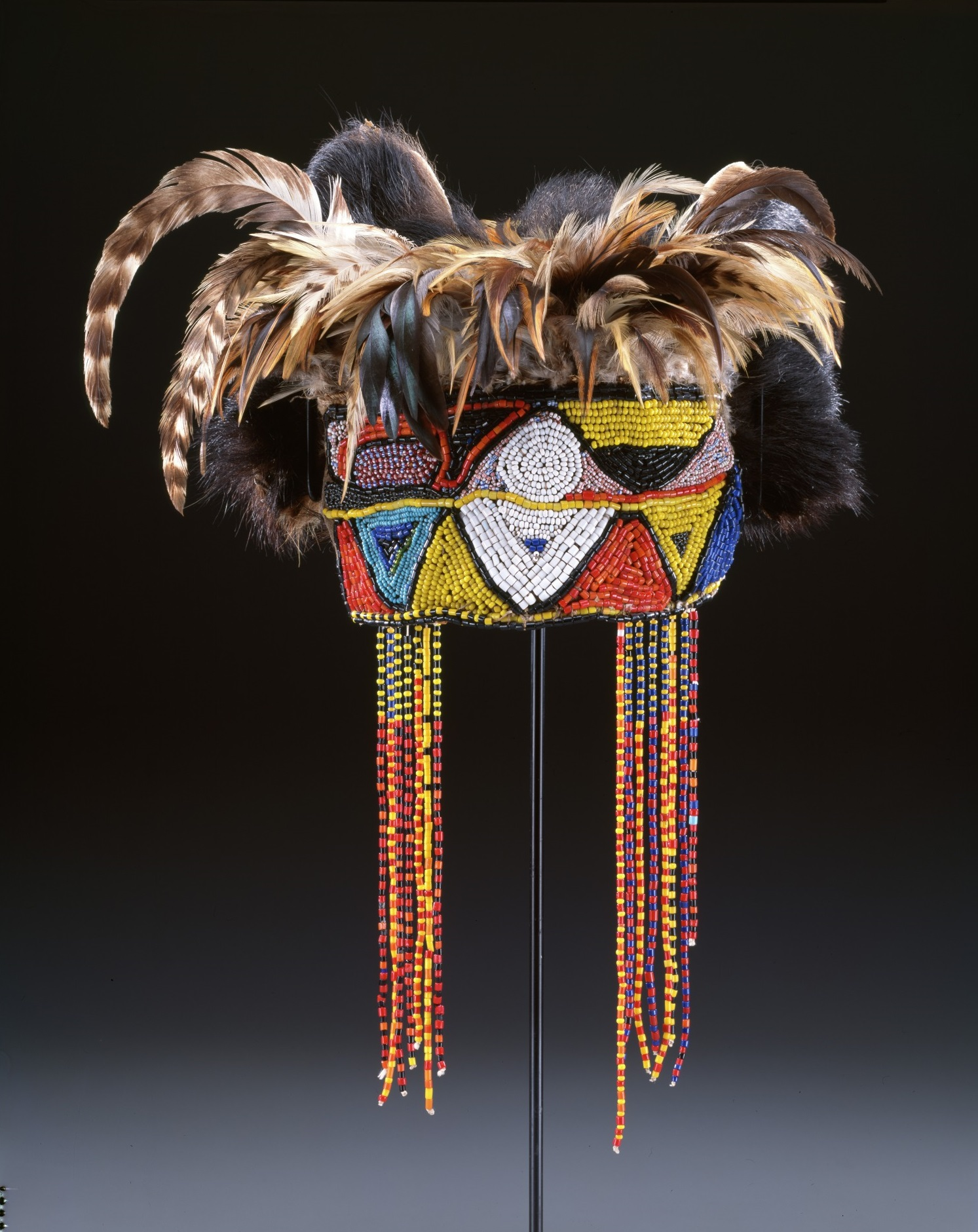 Diviners headdress (nkaka), Tabwa peoples, mid–20th century, Democratic Republic of the Congo, Africa, leather, fiber, beads, and feathers, Dallas Museum of Art, gift of The Cecil and Ida Green Foundation 1999.62